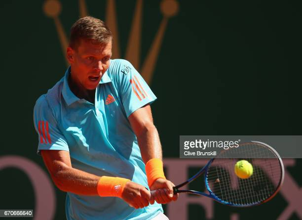 Tomas Berdych of the Czech Republic plays a backhand against Marin Cillic of Croatia in his third round match on day five of the Monte Carlo Rolex...