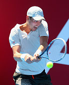 Tomas Berdych of the Czech Republic plays a backhand during his match against Kei Nishikori of Japan during day four of the AAMI Classic at Kooyong...