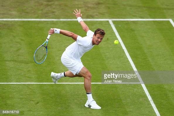 Tomas Berdych of The Czech republic plays a backhand during the Men's Singles first round match against Ivan Dodig of Croatia on day two of the...