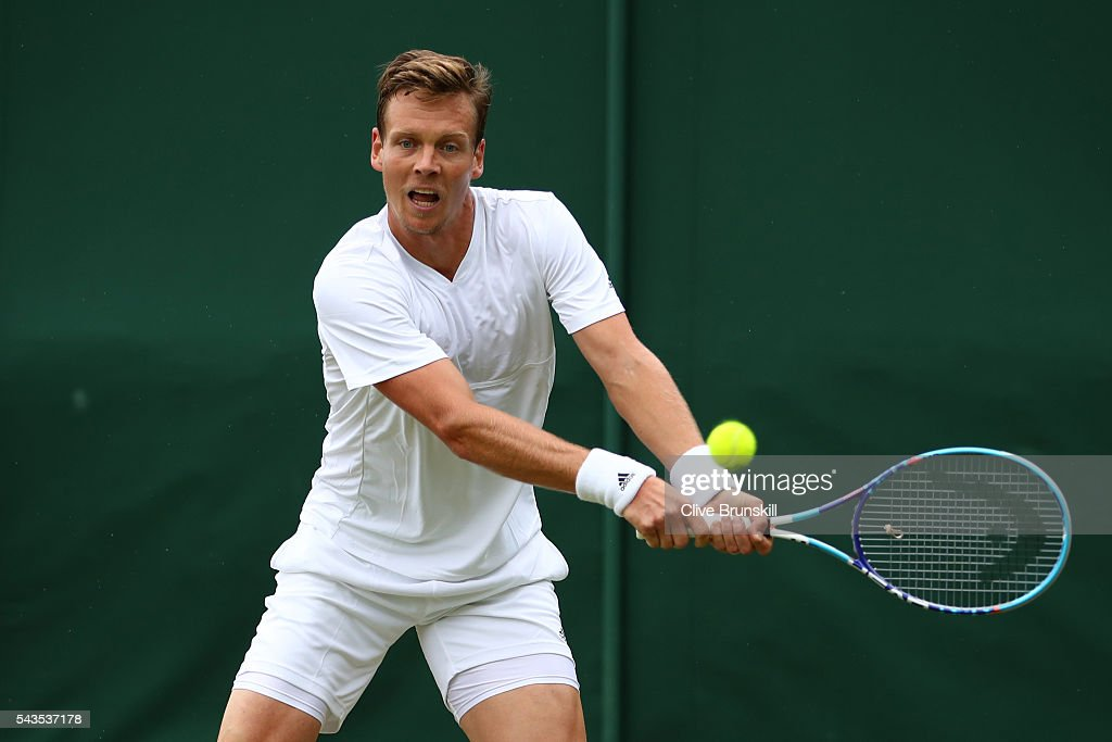 <a gi-track='captionPersonalityLinkClicked' href=/galleries/search?phrase=Tomas+Berdych&family=editorial&specificpeople=239147 ng-click='$event.stopPropagation()'>Tomas Berdych</a> of The Czech republic plays a backhand during the Men's Singles first round match against Ivan Dodig of Croatia on day three of the Wimbledon Lawn Tennis Championships at the All England Lawn Tennis and Croquet Club on June 29, 2016 in London, England.