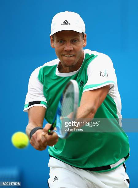 Tomas Berdych of The Czech Republic plays a backhand during the mens singles quarter final match against Feliciano Lopez of Spain on day five of the...