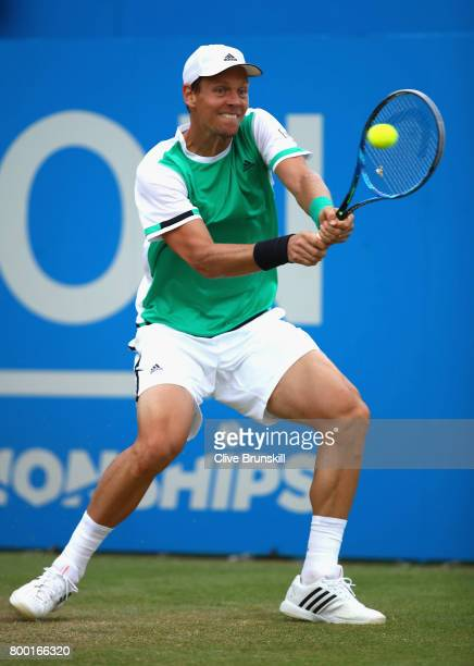 Thomas Berdych of The Czech Republic plays a backhand during the mens singles quarter final match against Feliciano Lopez of Spain on day five of the...