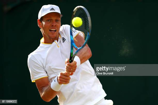 Tomas Berdych of The Czech Republic plays a backhand during the Gentlemen's Singles fourth round match against Dominic Thiem of Austria on day seven...