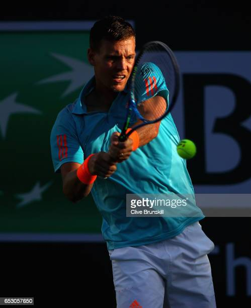 Tomas Berdych of the Czech Republic plays a backhand in his third round match against Yoshihito Nishioka of Japan during day eight of the BNP Paribas...