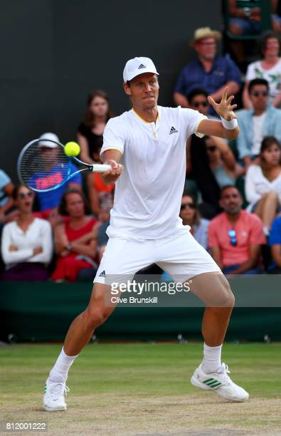 Tomas Berdych of The Czech Republic plays a forehand after the Gentlemen's Singles fourth round match against Dominic Thiem of Austria on day seven...