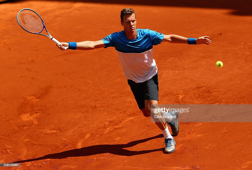 <a gi-track='captionPersonalityLinkClicked' href=/galleries/search?phrase=Tomas+Berdych&family=editorial&specificpeople=239147 ng-click='$event.stopPropagation()'>Tomas Berdych</a> of the Czech Republic plays a forehand against Denis Istomin of Uzbekistan in their second round match during day five of the Mutua Madrid Open tennis tournament at the Caja Magica on May 04, 2016 in Madrid.