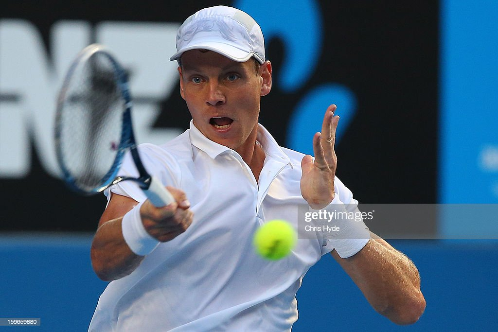 Tomas Berdych of the Czech Republic plays a forehand in his third round match against Jurgen Melzer of Austria during day five of the 2013 Australian Open at Melbourne Park on January 18, 2013 in Melbourne, Australia.