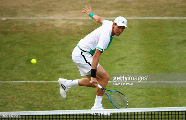 Thomas Berdych of The Czech Republic plays a volley during the mens singles quarter final match against Feliciano Lopez of Spain on day five of the...