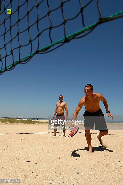 Tomas Berdych of the Czech Republic plays paddle ball off court on day eight of the 2012 Australian Open at St Kilda beach on January 23 2012 in...