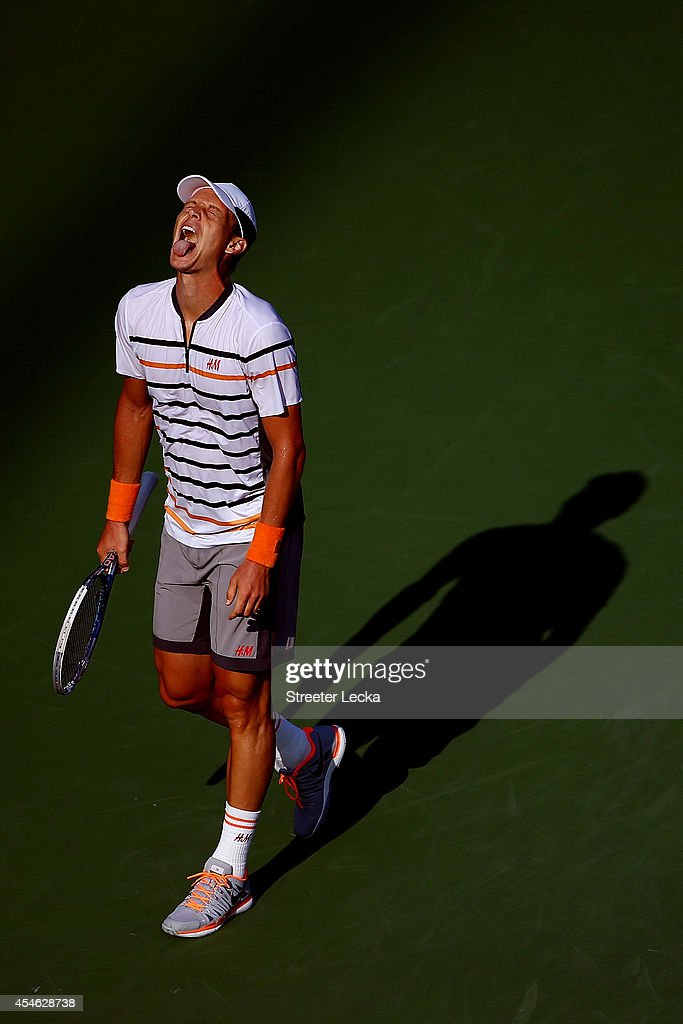 <a gi-track='captionPersonalityLinkClicked' href=/galleries/search?phrase=Tomas+Berdych&family=editorial&specificpeople=239147 ng-click='$event.stopPropagation()'>Tomas Berdych</a> of the Czech Republic reacts against Marin Cilic of Croatia during their men's singles quarterfinal match on Day Eleven of the 2014 US Open at the USTA Billie Jean King National Tennis Center on September 3, 2014 in the Flushing neighborhood of the Queens borough of New York City.