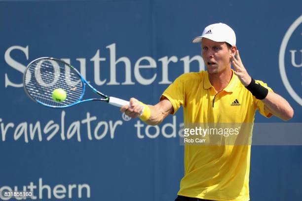 Tomas Berdych of the Czech Republic returns a shot against Juan Martin Del Potro of Argentina during the Western and Southern Open on August 15 2017...