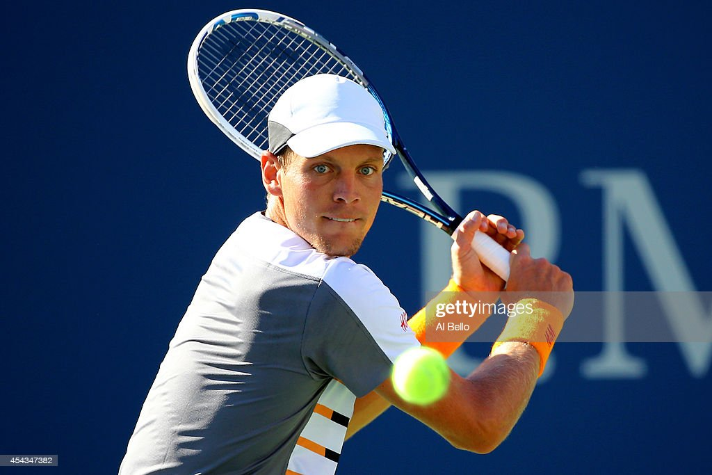 Tomas Berdych of the Czech Republic returns a shot against Martin Klizan of Slovakia during their men's singles second round on Day Five of the 2014...