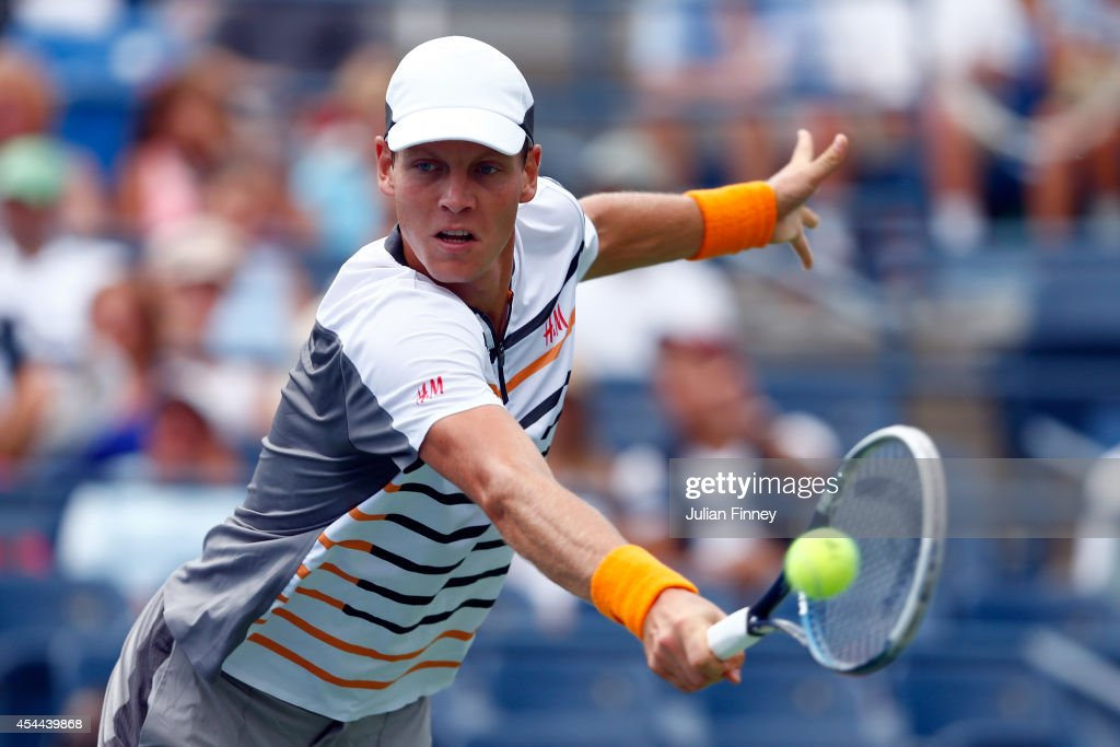Tomas Berdych of the Czech Republic returns a shot against Teymuraz Gabashvili of Russia during their men's singles third round match on Day Seven of...