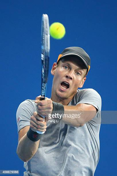 Tomas Berdych of the Czech Republic returns a shot during his semifinal match against Martin Klizan of Slovakia on day eight of the China Open at the...