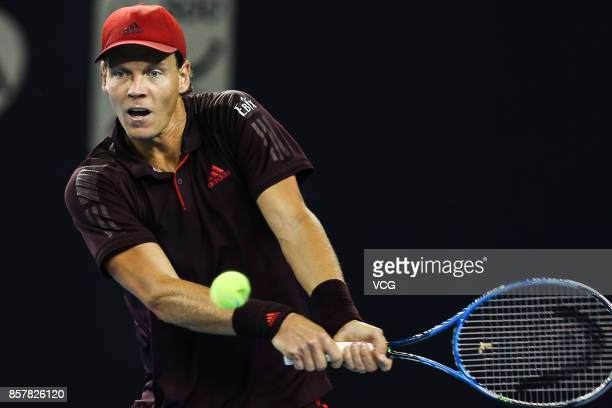 Tomas Berdych of the Czech Republic returns a shot during the Men's singles second round match against Andrey Rublev of Russia on day six of the 2017...