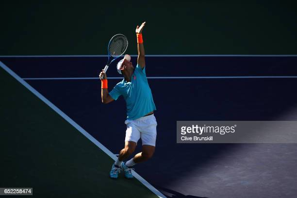 Tomas Berdych of the Czech Republic serves against Bjorn Fratangelo of the United States in their second round match during day six of the BNP...