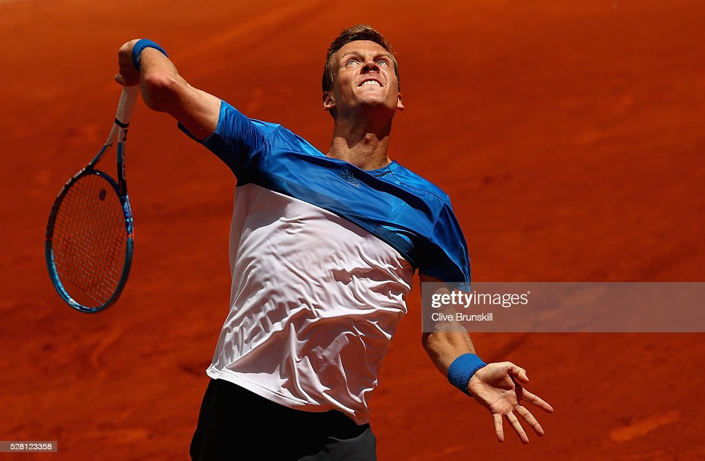 <a gi-track='captionPersonalityLinkClicked' href=/galleries/search?phrase=Tomas+Berdych&family=editorial&specificpeople=239147 ng-click='$event.stopPropagation()'>Tomas Berdych</a> of the Czech Republic serves against Denis Istomin of Uzbekistan in their second round match during day five of the Mutua Madrid Open tennis tournament at the Caja Magica on May 04, 2016 in Madrid.