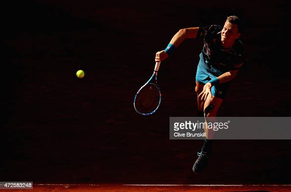 Tomas Berdych of the Czech Republic serves against John Isner of the United States in their quarter final match during day seven of the Mutua Madrid...