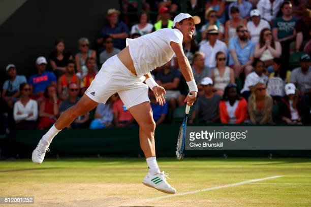 Tomas Berdych of The Czech Republic serves during the Gentlemen's Singles fourth round match against Dominic Thiem of Austria on day seven of the...