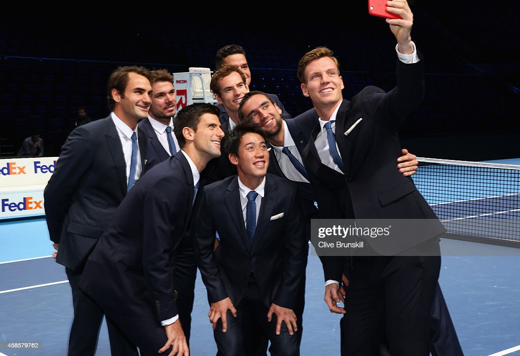 <a gi-track='captionPersonalityLinkClicked' href=/galleries/search?phrase=Tomas+Berdych&family=editorial&specificpeople=239147 ng-click='$event.stopPropagation()'>Tomas Berdych</a> of the Czech Republic takes a group selfie of Stan Wawrinka of Switzerland,<a gi-track='captionPersonalityLinkClicked' href=/galleries/search?phrase=Milos+Raonic&family=editorial&specificpeople=5421226 ng-click='$event.stopPropagation()'>Milos Raonic</a> of Canada,<a gi-track='captionPersonalityLinkClicked' href=/galleries/search?phrase=Novak+Djokovic&family=editorial&specificpeople=588315 ng-click='$event.stopPropagation()'>Novak Djokovic</a> of Serbia,<a gi-track='captionPersonalityLinkClicked' href=/galleries/search?phrase=Kei+Nishikori&family=editorial&specificpeople=4432498 ng-click='$event.stopPropagation()'>Kei Nishikori</a> of Japan,<a gi-track='captionPersonalityLinkClicked' href=/galleries/search?phrase=Andy+Murray+-+Tennis+Player&family=editorial&specificpeople=200668 ng-click='$event.stopPropagation()'>Andy Murray</a> of Great Britain,<a gi-track='captionPersonalityLinkClicked' href=/galleries/search?phrase=Roger+Federer&family=editorial&specificpeople=157480 ng-click='$event.stopPropagation()'>Roger Federer</a> of Switzerland and <a gi-track='captionPersonalityLinkClicked' href=/galleries/search?phrase=Marin+Cilic&family=editorial&specificpeople=553788 ng-click='$event.stopPropagation()'>Marin Cilic</a> of Croatia after the mens singles official group shot had been taken prior to the start of the Barclays ATP World Tour Finals tennis previews at the O2 Arena on November 7, 2014 in London, England.