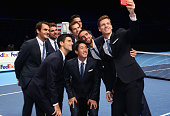 Tomas Berdych of the Czech Republic takes a group selfie of Stan Wawrinka of SwitzerlandMilos Raonic of CanadaNovak Djokovic of SerbiaKei Nishikori...