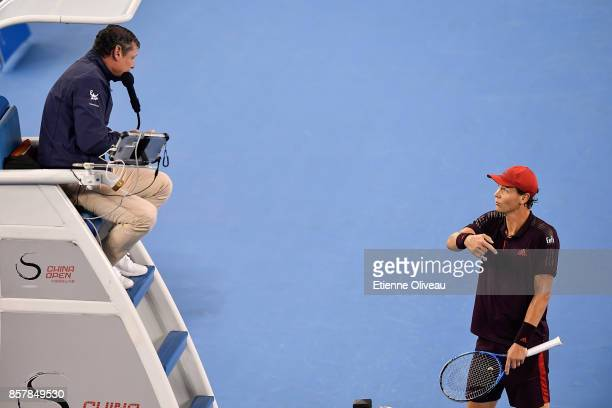 Tomas Berdych of the Czech Republic talks to the referee during his Men's singles second round match against Andrey Rublev of Russia on day six of...