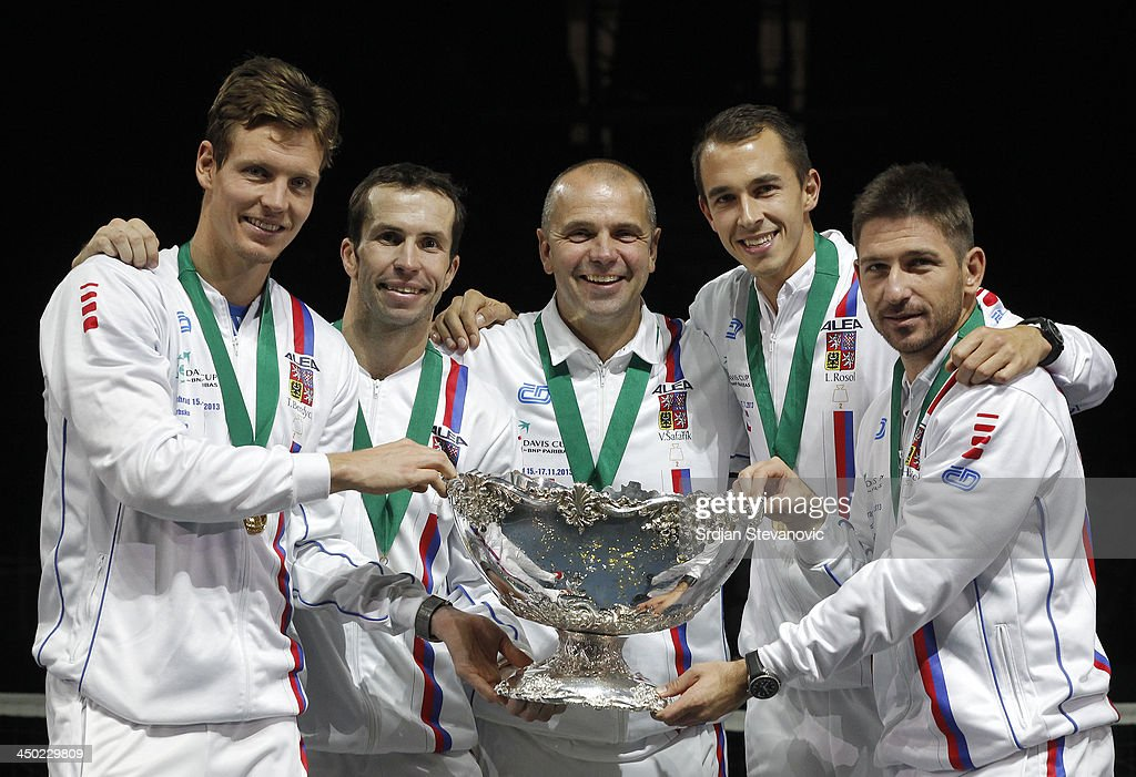 <a gi-track='captionPersonalityLinkClicked' href=/galleries/search?phrase=Tomas+Berdych&family=editorial&specificpeople=239147 ng-click='$event.stopPropagation()'>Tomas Berdych</a>, Radek Stepanek team captain Vladimir Safarik, <a gi-track='captionPersonalityLinkClicked' href=/galleries/search?phrase=Lukas+Rosol&family=editorial&specificpeople=4100845 ng-click='$event.stopPropagation()'>Lukas Rosol</a> and Jan Hayek of Czech Republic hold the winners trophy aloft after a 3-2 victory against Serbia during day three of the Davis Cup World Group Final between Serbia and Czech Republic at Kombank Arena on November 17, 2013 in Belgrade, Serbia.