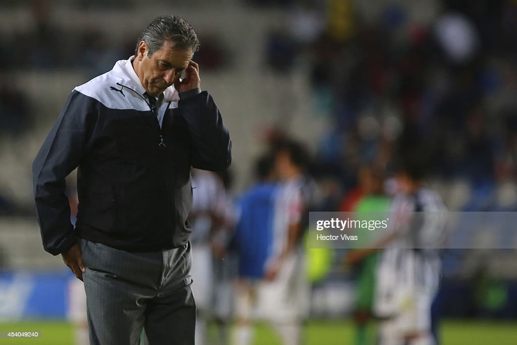 Tomas Boy, Head Coach of Atlas looks dejected during a match between Pachuca and Atlas as part of 6th round Apertura 2014 Liga MX at Hidalgo Stadium on August 23, 2014 in Pachuca, Mexico.