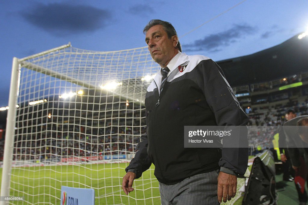 Tomas Boy Head Coach of Atlas walks out the field during a match between Pachuca and Atlas as part of 6th round Apertura 2014 Liga MX at Hidalgo Stadium on August 23, 2014 in Pachuca, Mexico.
