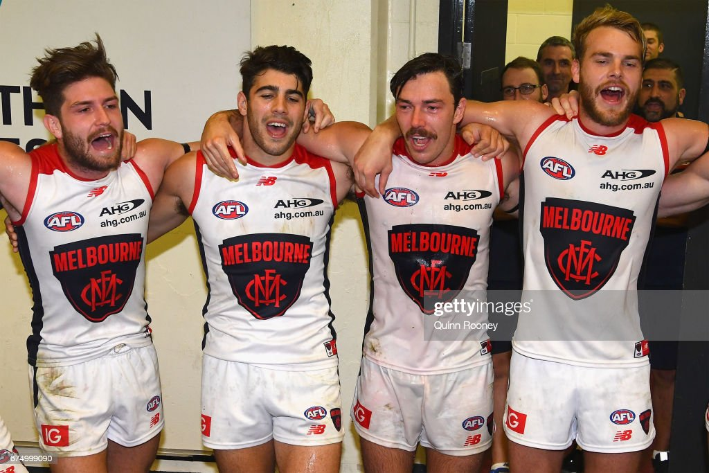 Tomas Bugg, Christian Petracca, Michael Hibberd and Jack Watts of the Demons sing the song in the rooms after winning the round six AFL match between the Essendon Bombers and the Melbourne Demons at Etihad Stadium on April 30, 2017 in Melbourne, Australia.