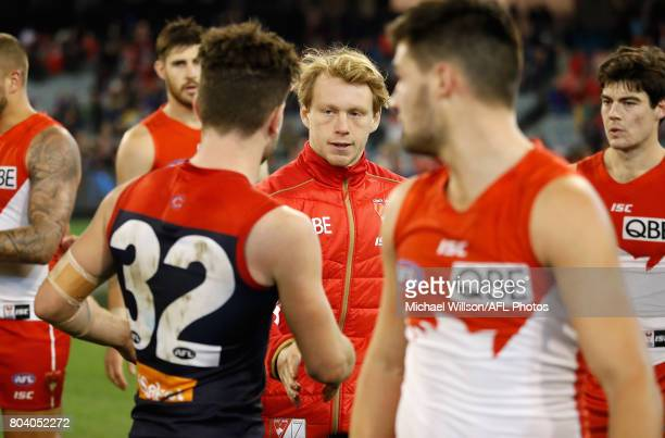 Tomas Bugg of the Demons and Callum Mills of the Swans shake hands after the 2017 AFL round 15 match between the Melbourne Demons and the Sydney...