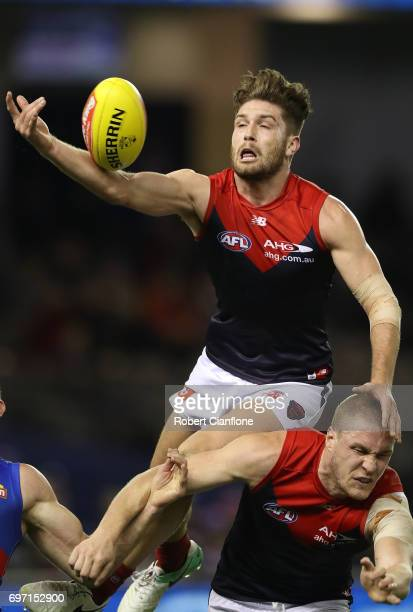 Tomas Bugg of the Demons attempts to mark during the round 13 AFL match between the Western Bulldogs and the Melbourne Demons at Etihad Stadium on...