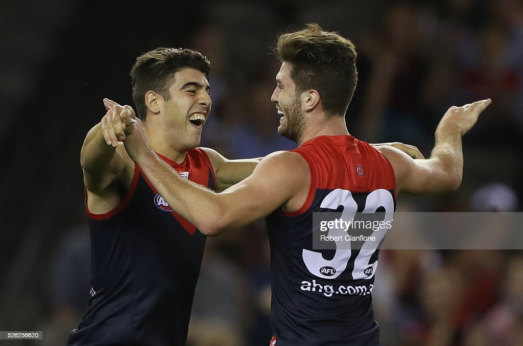 Tomas Bugg of the Demons celebrates a goal with Christian Petracca of the Demons during the round six AFL match between the Melbourne Demons and the St Kilda Saints at Etihad Stadium on April 30, 2016 in Melbourne, Australia.