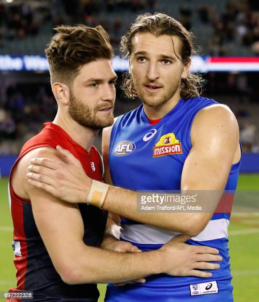Tomas Bugg of the Demons chats with Marcus Bontempelli of the Bulldogs during the 2017 AFL round 13 match between the Western Bulldogs and the...
