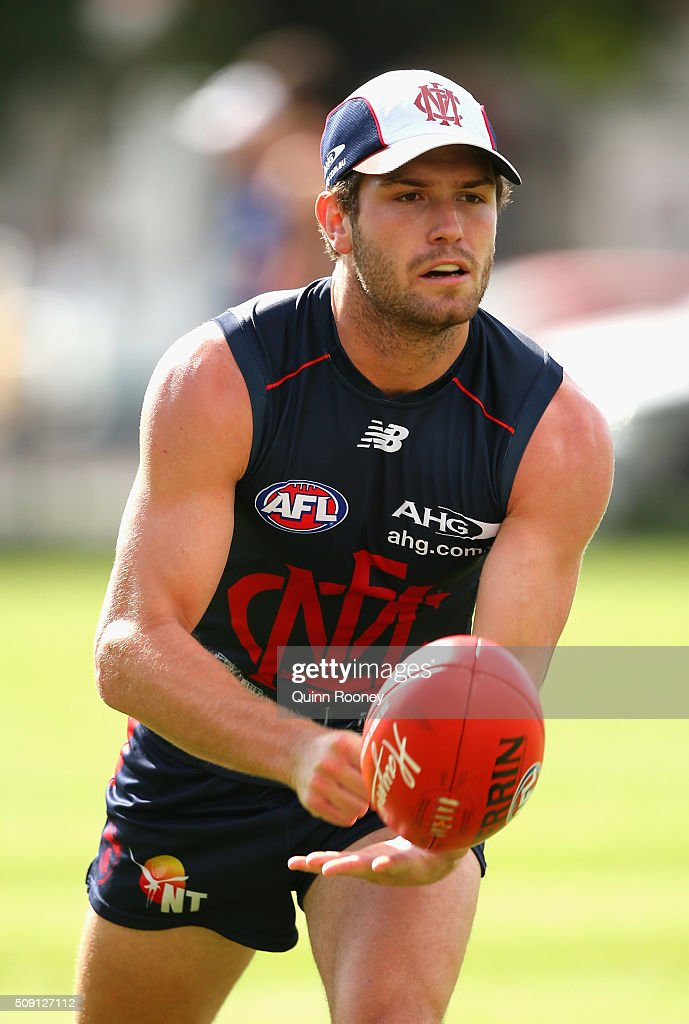 Tomas Bugg of the Demons handballs during a Melbourne Demons AFL pre-season training session at Gosch's Paddock on February 9, 2016 in Melbourne, Australia.
