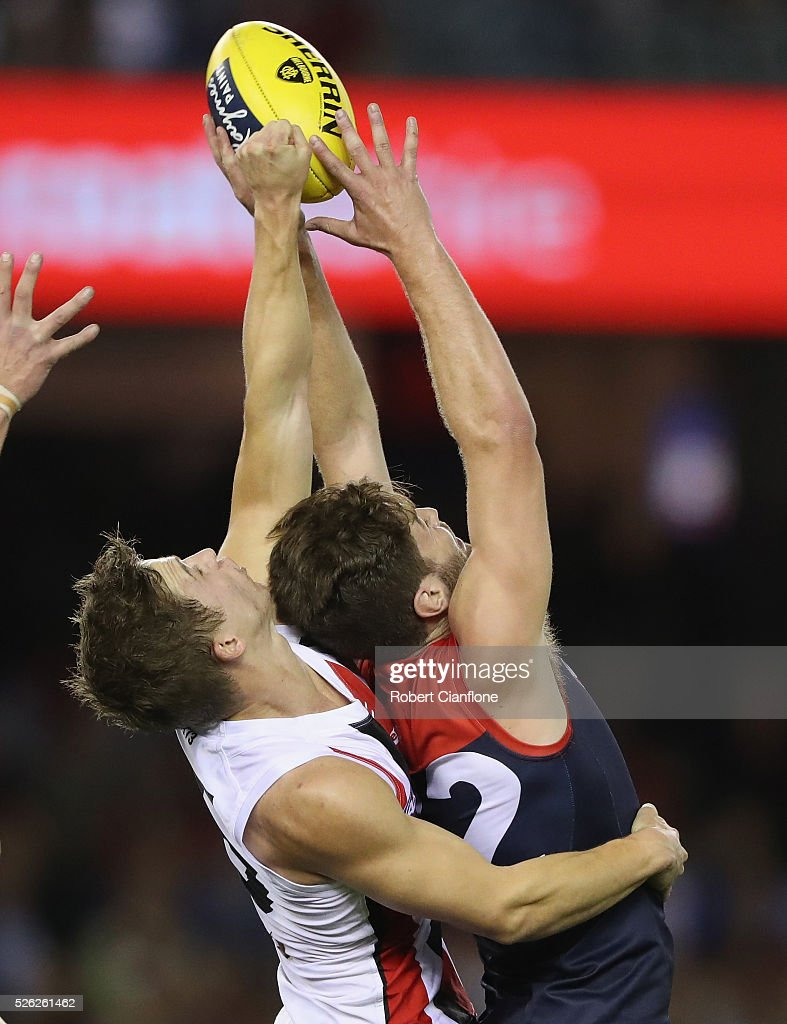 Tomas Bugg of the Demons is challenged by Jack Billings of the Saints during the round six AFL match between the Melbourne Demons and the St Kilda Saints at Etihad Stadium on April 30, 2016 in Melbourne, Australia.
