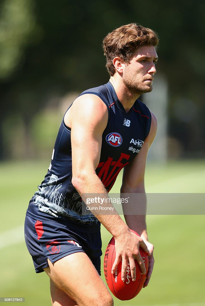 Tomas Bugg of the Demons kicks during a Melbourne Demons AFL pre-season training session at Gosch's Paddock on February 9, 2016 in Melbourne, Australia.