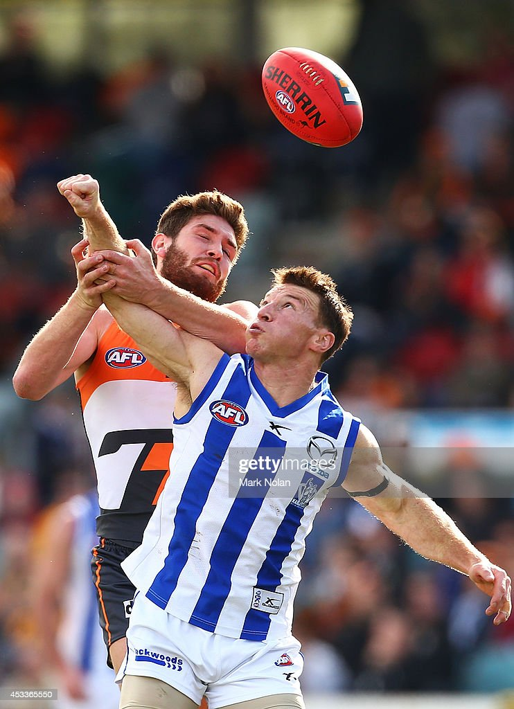 Tomas Bugg of the Giants and <a gi-track='captionPersonalityLinkClicked' href=/galleries/search?phrase=Brent+Harvey&family=editorial&specificpeople=214661 ng-click='$event.stopPropagation()'>Brent Harvey</a> of the Kangaroos contest possession during the round 20 AFL match between the Greater Western Sydney Giants and the North Melbourne Kangaroos at Stratrack Oval on August 9, 2014 in Canberra, Australia.