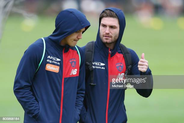 Tomas Bugg who will be up at the AFL tribunal for striking Callum Mills of Sydney Swans arrives with Jack Trengrove during a Melbourne Demons AFL...