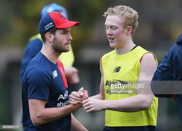 Tomas Bugg who will be up at the AFL tribunal for striking Callum Mills of Sydney Swans gets support from Clayton Oliver during a Melbourne Demons...