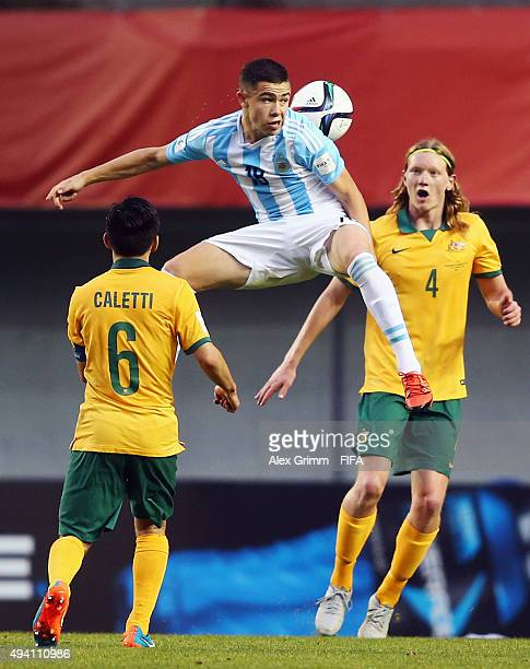 Tomas Conechny of Argentina is challenged by Joe Caletti and Kye Rowles of Australia during the FIFA U17 World Cup Chile 2015 Group C match between...