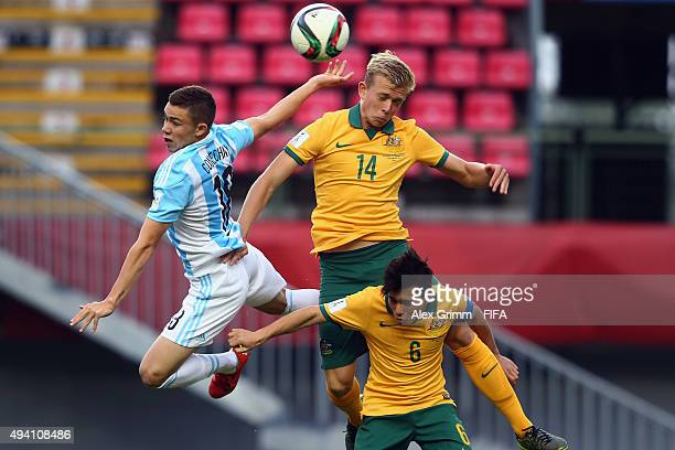 Tomas Conechny of Argentina is challenged by Joshua Laws and Joe Caletti of Australia during the FIFA U17 World Cup Chile 2015 Group C match between...