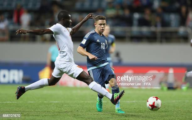 Tomas Conechny of Argentina passes as Morlaye Sylla of Guinea jumps in during the FIFA U20 World Cup Korea Republic 2017 group A match between Guinea...