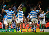 Tomas Cubelli of Argentina celebrates next to Ramiro Herrera and Marcos Ayerza after winning their 2015 Rugby World Cup Quarter Final match between...
