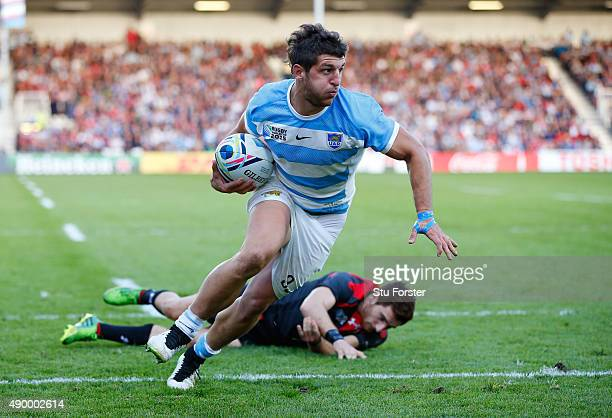 Tomas Cubelli of Argentina is tackled by Vasil Lobzhanidze of Georgia on the way to scoring his teams second try during the 2015 Rugby World Cup Pool...