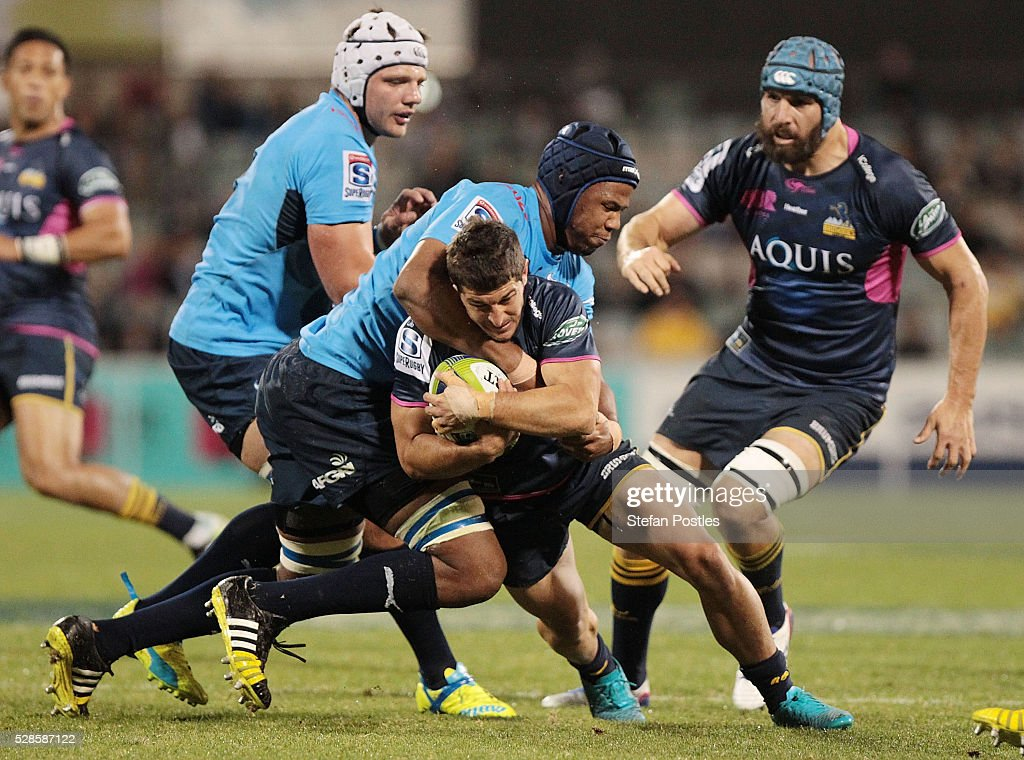 Tomas Cubelli of the Brumbies is tackled during the round 11 Super Rugby match between the Brumbies and the Bulls at GIO Stadium on May 6, 2016 in Canberra, Australia.