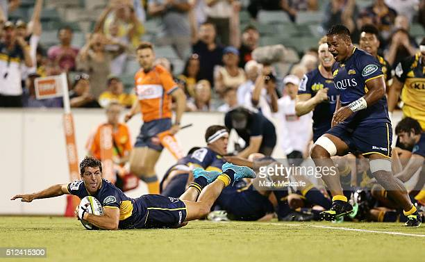 Tomas Cubelli of the Brumbies scores a try during the round one Super Rugby match between the Brumbies and the Hurricanes at GIO Stadium on February...