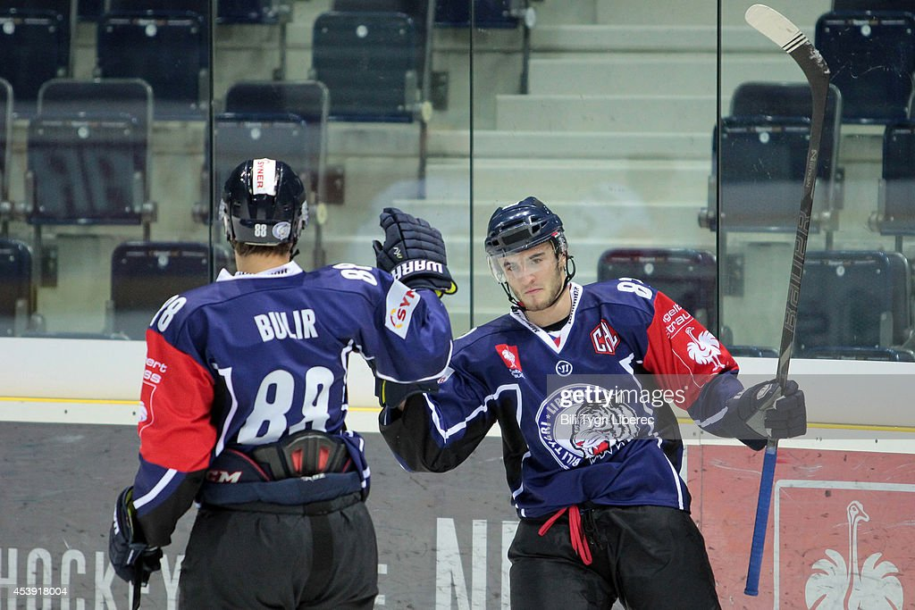 Tomas Filippi (R) and Michal Bulir of Bili Tygri Liberec celebrate goal during the Champions Hockey League group stage game between Bili Tygri Liberec and Karpat Oulu on August 21, 2014 in Liberec, Czech Republic.