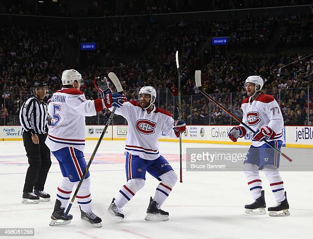 Tomas Fleischmann Greg Pateryn and Tom Gilbert of the Montreal Canadiens celebrate Fleischmann's first period goal against the New York Islanders at...