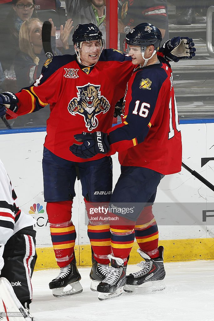 <a gi-track='captionPersonalityLinkClicked' href=/galleries/search?phrase=Tomas+Fleischmann&family=editorial&specificpeople=554398 ng-click='$event.stopPropagation()'>Tomas Fleischmann</a> #14 is congratulated by <a gi-track='captionPersonalityLinkClicked' href=/galleries/search?phrase=Aleksander+Barkov&family=editorial&specificpeople=8760147 ng-click='$event.stopPropagation()'>Aleksander Barkov</a> #16 of the Florida Panthers after scoring a third period goal against the Chicago Blackhawks at the BB&T Center on October 22, 2013 in Sunrise, Florida. The Blackhawks defeated the Panthers 3-2 in a shoot-out.